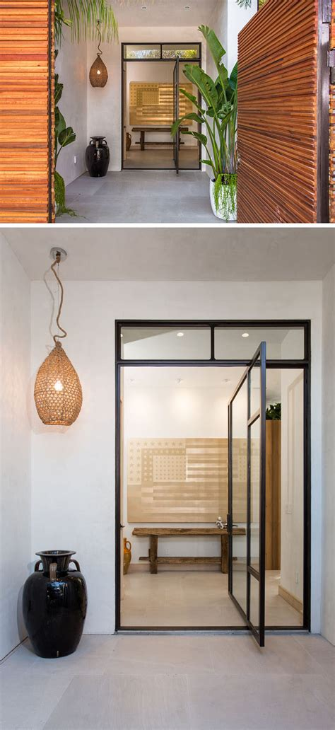 Pivoting Front Door 11 Pivoting Glass Doors That Make A Statement And Let Light In Contemporist
