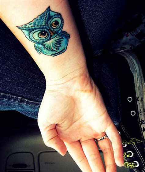 owl tattoo arm tumblr 42 caged and flying bird tattoos and designs