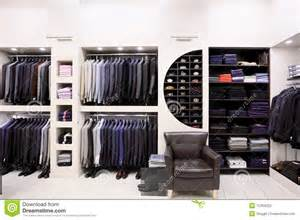 Luxury men s clothes and accessories in modern shop interior