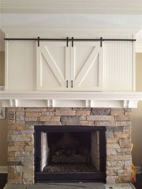 Barn Door Tv Cover 17 Best Images About Tv On Sliding Barn Doors Barn Doors And Mantels