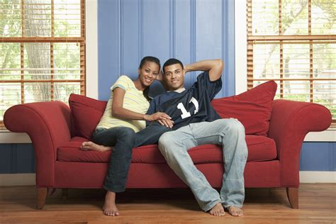 couple on sofa too blessed to be stressed muwado