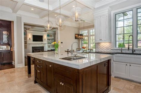 Ambient lighting compliments pendant lights above the kitchen island