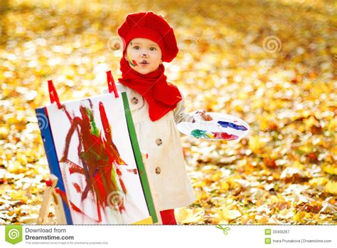painting for child child drawing on easel in autumn park creative