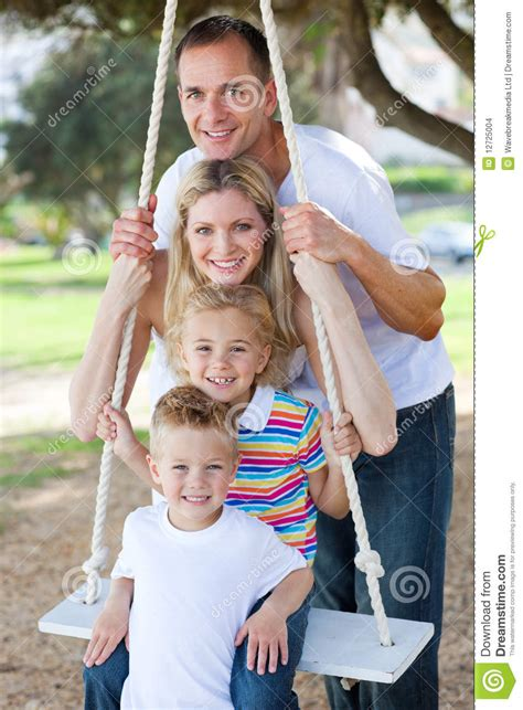family swing happy family playing on a swing stock images image 12725004