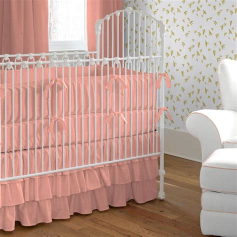 solid light coral crib bedding carousel designs