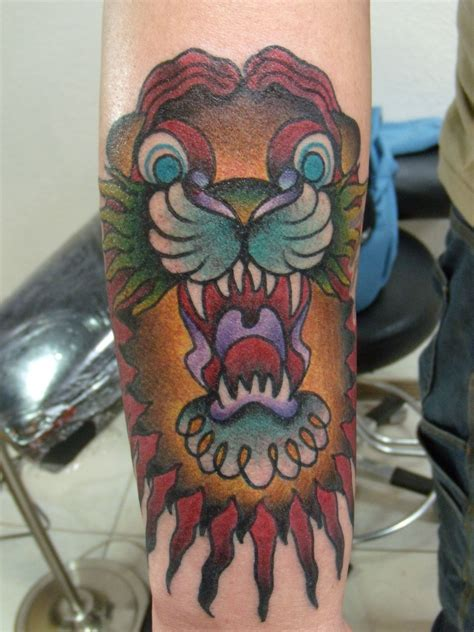 traditional lion tattoo new school design tattoos