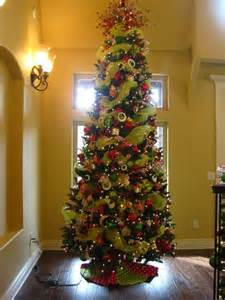Decorating christmas tree with ribbon decorated christmas trees p