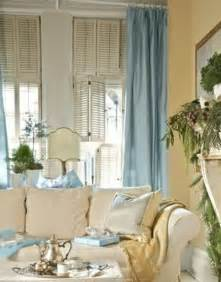 curtains for light yellow walls yellow walls blue curtains living room juxtapost