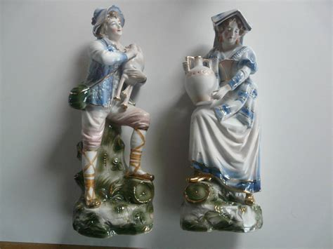 nice pair of large continental porcelain bisque lady and