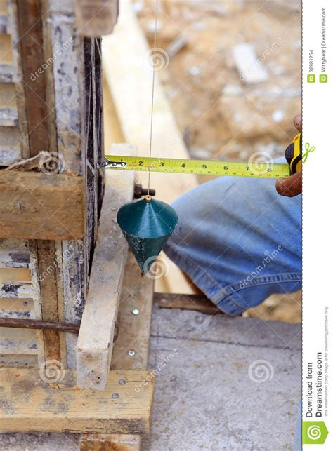 How Do You Use A Plumb Bob by Labor Using A Plumb Bob For Check Stock Images Image