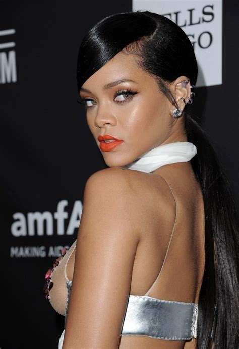 hair swoop to the side slick back on one side for african american women rihanna ponytail rihanna looks stylebistro