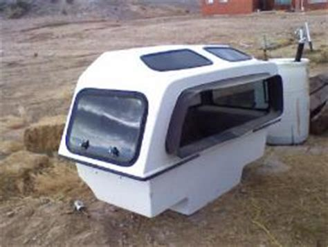 cost to ship small fiberglass pick up sleeper from