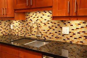 Glass tile backsplash with multiple colored tiles and accents of