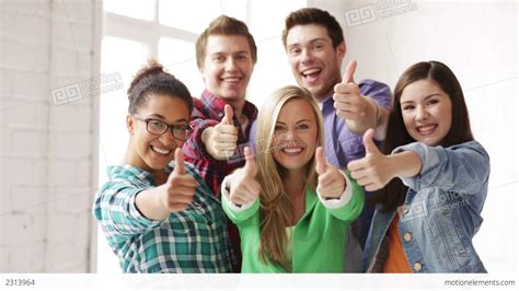 hipster male student showing thumb group stock photo students in school showing thumbs up stock video footage
