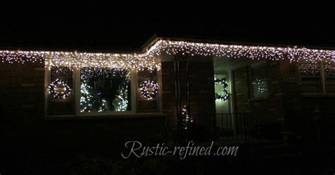 easy way to hang christmas lights on a christmas tree hang outdoor lights quickly tutorial hometalk