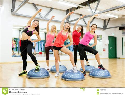 imagenes de step up muss group of female doing aerobics with half ball stock image