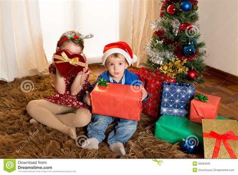 Happy Cute Little Kid Santa Claus Hat And His Beautiful ... Happy Kids Opening Christmas Presents