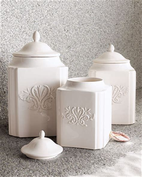 three white ceramic canisters
