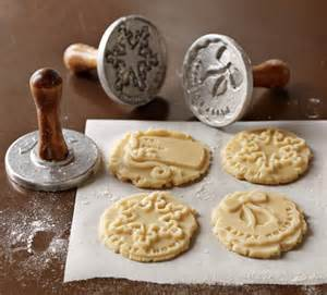 Decorate christmas cookies with holiday cookie stamps