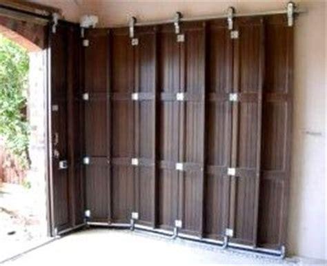 Sideways Garage Door These Garage Doors Slide Sideways Instead Of The Traditional Overhead Door I Like The Idea But