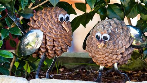 owl creations from pine cones and fluff how to make pine cone owls better homes gardens