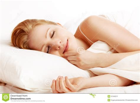 wake up everybody no more sleeping in bed beautiful woman sleeping and smiles in his sleep in bed stock image image 31340211