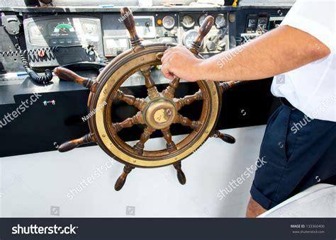 boat driving wheel captain hand on steering wheel motor stock photo 133360400