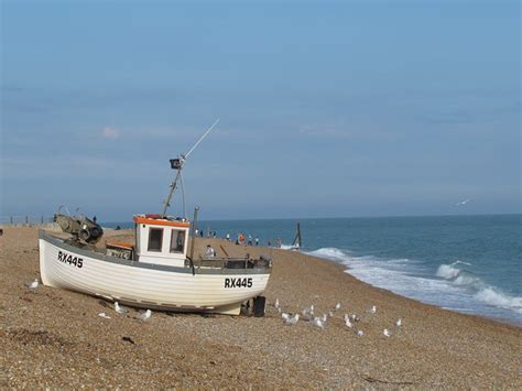 small boat kept on large boat fishing boat on hastings beach 169 stephen craven cc by sa 2