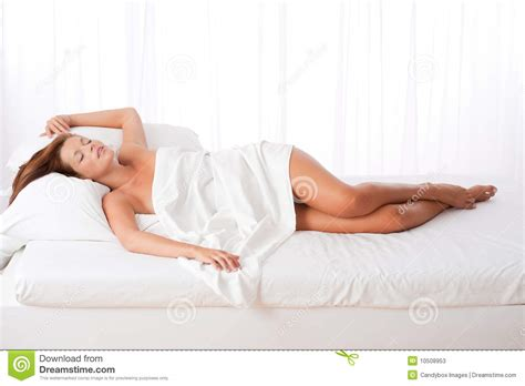 lying on bed long shot of woman lying in bed stock photos image 10508953