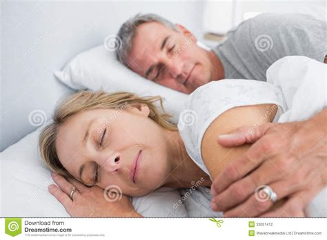 spooning in bed photos calm couple sleeping and spooning in bed stock photo image 33051412