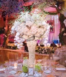 Wedding reception venue ivory blush nude wedding flower centerpiece