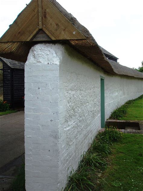 Thatched Cob Wall Here S Another Cob Wall With Brick Cob Garden Wall