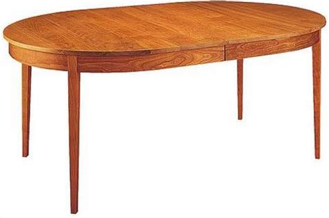oval ring extension table with four legs traditional