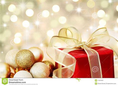 christmas gift on defocused lights background stock image