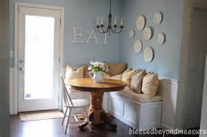 interior wooden table with white painting banquette