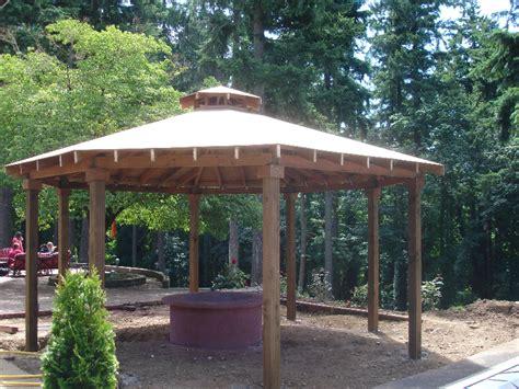 custom gazebo with cedar shake roof and fire pit build