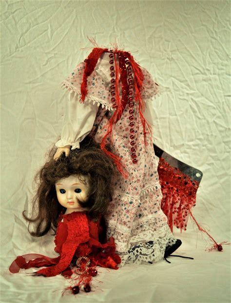 porcelain doll horror creepy gory horror porcelain doll doll beheaded