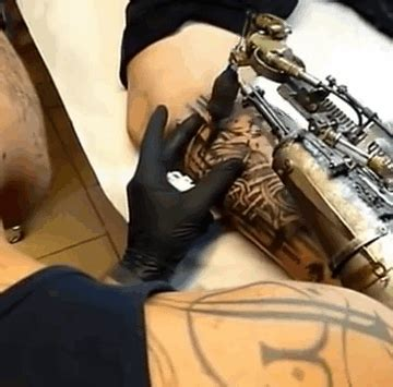 tattoo gun how it works he received tattoo gun prosthetic arm as a gift and is
