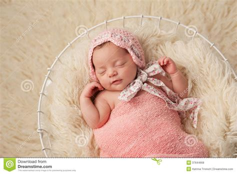 baby photo ideas royalty free digital stock photos for newborn baby girl in basket wearing a pink bonnet stock