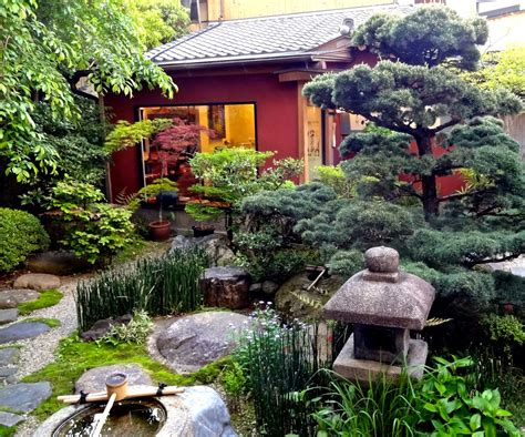 zen water garden meandering paths stone lantern water basin koi pond
