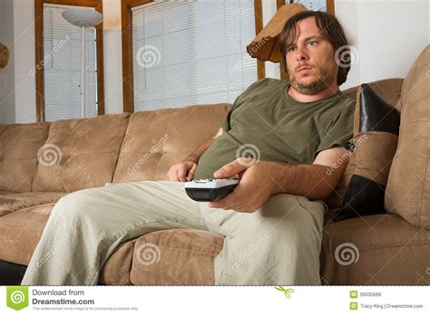 slob on couch photo fat lazy guy watching the tv pics stock photos all