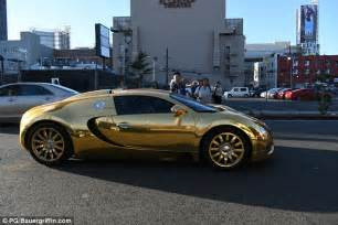 Bugatti In Gold Foxx Pulls Up To Premiere In Gold Bugatti Veyron