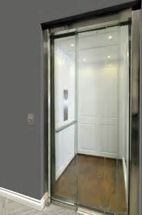 home elevator with glass doors transitional hall toronto by savaria