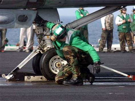 Naval Sw taking off from an aircraft carrier catapults and taking