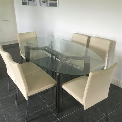 glass dining table and 6 leather chairs for sale in