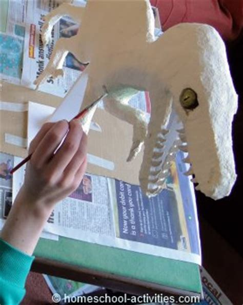 How To Make A Dinosaur Model From Paper Mache - make a velociraptor dinosaur with our paper mache clay recipe