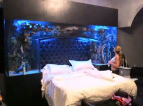 bed with fish tank headboard nfl baller chad ochocinco installs a fish tank headboard
