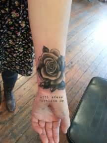 black rose tattoo studio a cover up black and grey on a wrist