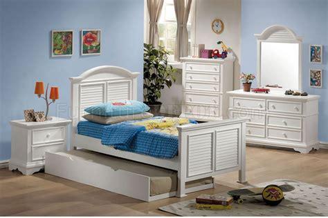white finish bedroom w louvered shutter bed design