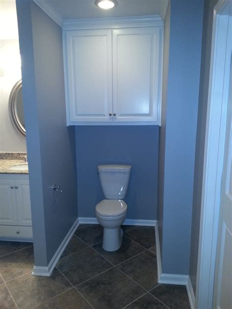 bathroom wall above toilet bathroom tall brown above toilet storage with doors and